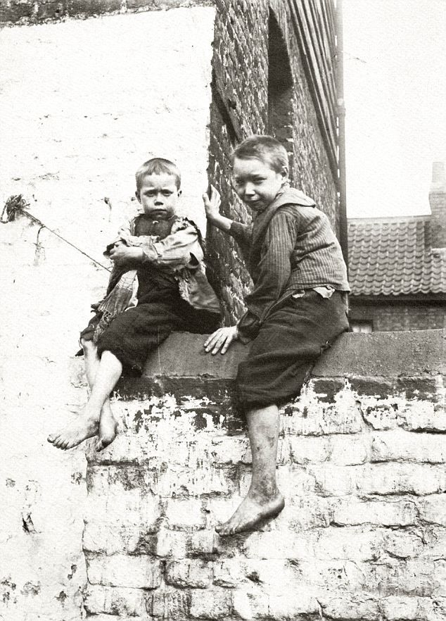 Britain's slumdogs: The ragged and filthy East End ...