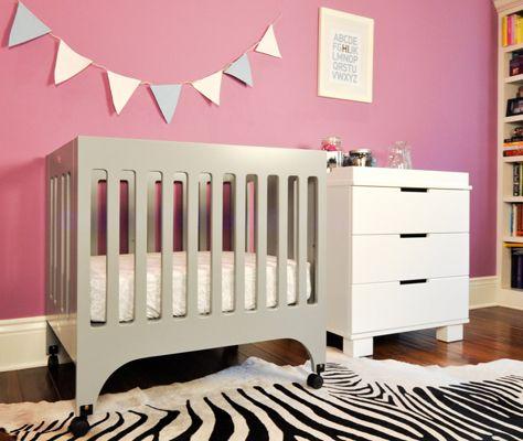 Roomshot of grey Grayson mini crib