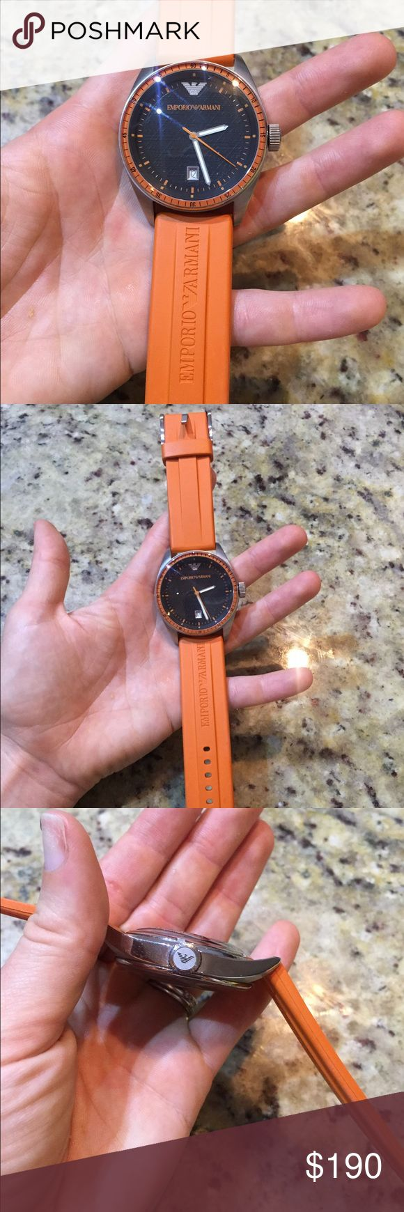 Emporio armani orange watch Emporio armani orange watch. Great condition. Has a small smudge/scratch on top left of watch face thats really not discernible, but wanted to mention it. Any questions please ask. Will take most reasonable offers Emporio Armani Accessories Watches