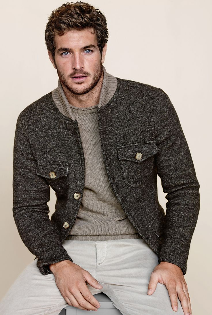 Shop this look for $156:  http://lookastic.com/men/looks/grey-crew-neck-sweater-and-charcoal-blazer-and-beige-chinos/815  — Grey Crew-neck Sweater  — Charcoal Blazer  — Beige Chinos