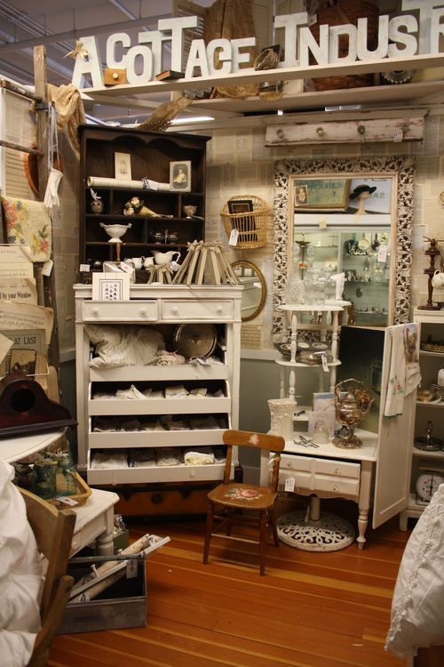 antique booth inspiration, book page wall and those fabric strip lampshades are so cute