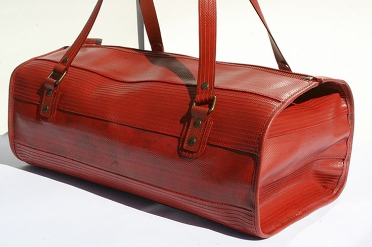 The Elvis & Kresse Overnight bag is made from genuine decommissioned fire-hose and a has a reclaimed military-grade parachute silk lining.