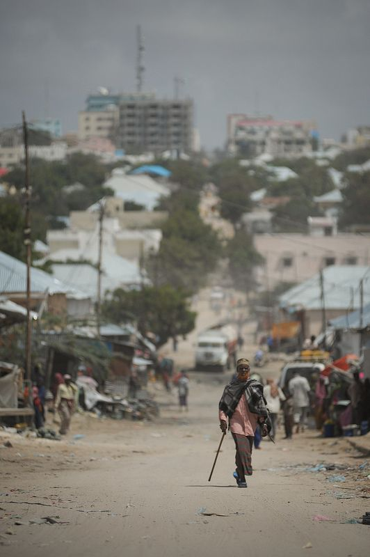 A man walks up a hill in front of Bakara Market in the capital of Mogadishu, Somalia, on October 2. Two decades after the infamous Battle of Mogadishu, in which the United States lost eighteen soldiers during a mission into Bakara Market, Somalia is finally showing signs of recovery from its more than two decades of civil war. Nowhere is this more evident than in Mogadishu's Bakara Market, where business is thriving and new shops continue to be opened everyday. AU UN IST PHOTO / TOBIN JONES.