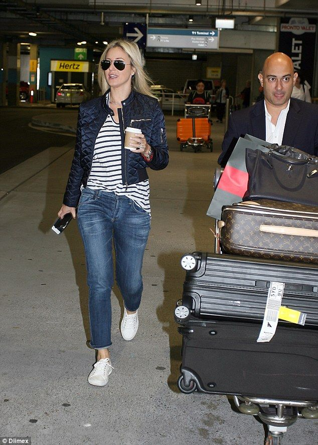 Diva demands! Roxy Jacenko touched down in Sydney on Wednesday and on her arrival, she was swiftly handed a fresh hot coffee from an assistant who then took over the pushing of her large stack of suitcases