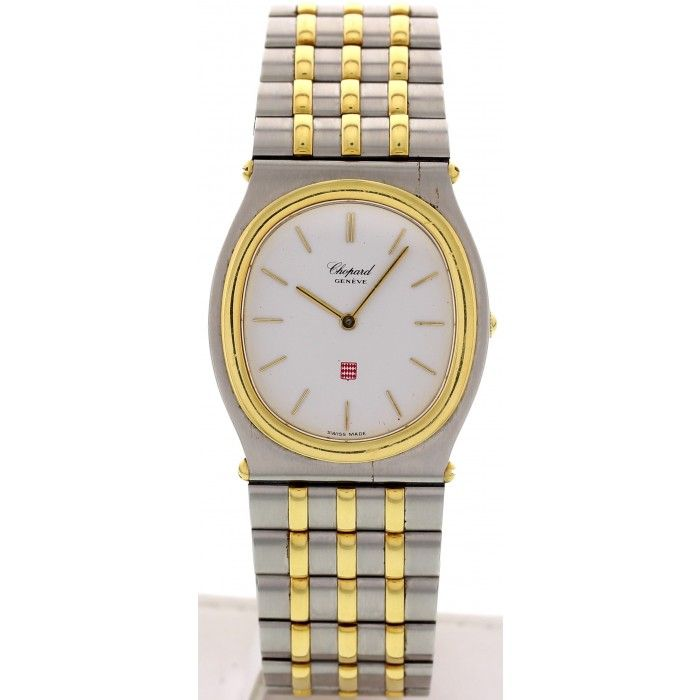 Stainless steel 29mm case with an 18k yellow gold bezel. 18k yellow gold and stainless steel bracelet; will fit an 8 inch wrist. Quartz movement.
