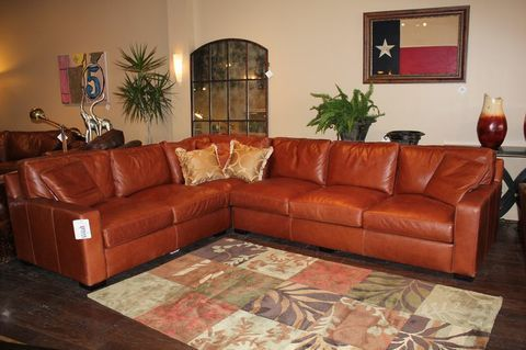 The rust color of this sectional is gorgeous  Orange