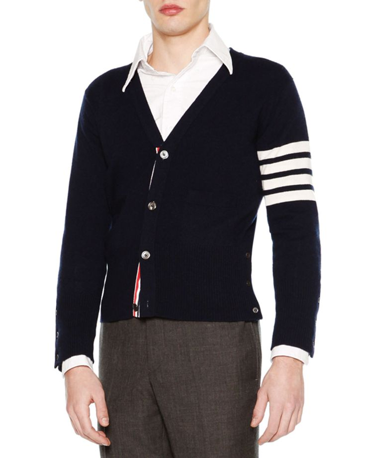 "Thom Browne classic cardigan. Approx. 24""L down center back. V neckline; button front. Long sleeves with four signature contrast stripes at left arm. Button cuffs and sides with striped facing. Ribbed"