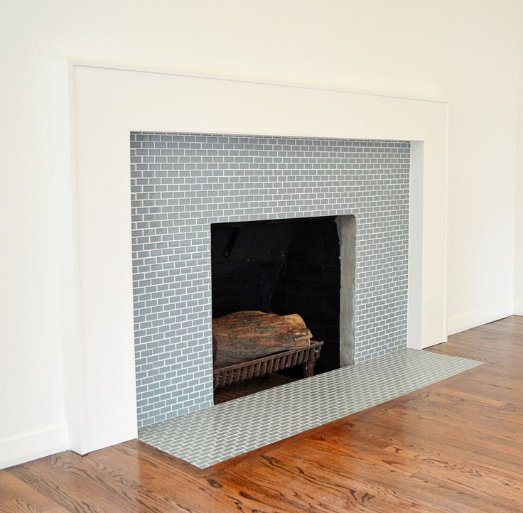 Ocean Mini Glass Tile Fireplace Surround  Could be nice as a horizontal accent tile in shower with larger white subway tiles.