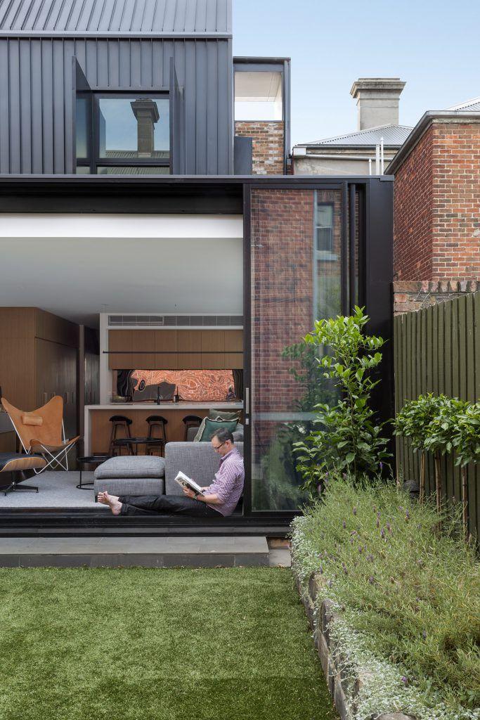 frame terrace....black framed windows slide away....  photo by mish edstein