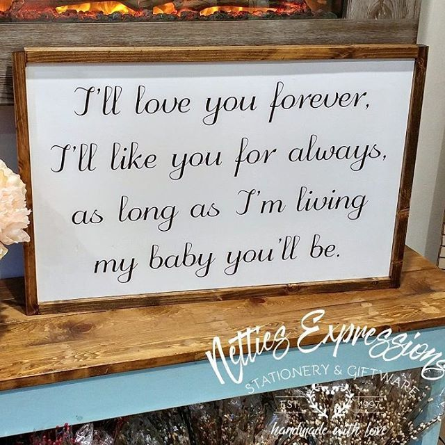 I'll love you forever, I'll like you for always as long as I'm living my baby you'll be. This framed wooden 16 x 25.5 sign is available through my Online Shop (link in bio⬆️) and through my retail location.  #nettiesexpressions #handmadeincan