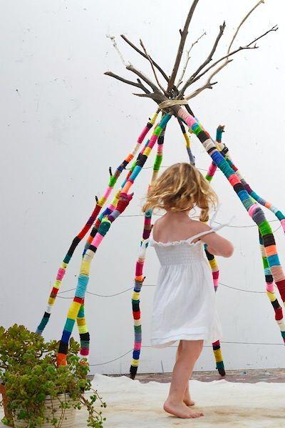 Yarn scraps wrapped tree branch teepee