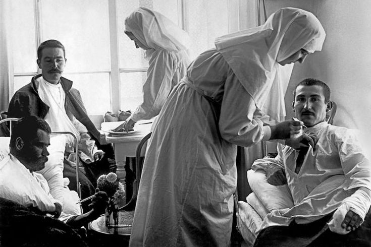 Sisters of mercy and wounded men in the hospital of the