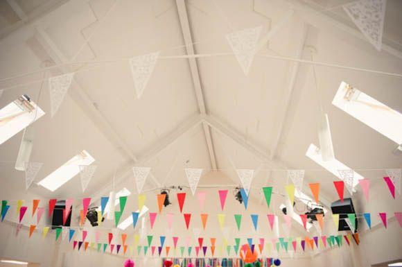 Colourful rainbow bunting. Need help with any aspects of wedding planning and styling? visit www.rosetintmywedding.co.uk #wedding #weddingdecor #weddingtables #weddingstyling