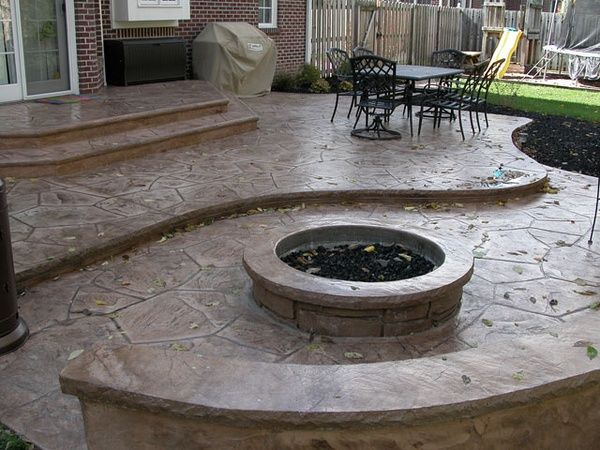 Stamped concrete patio, fire pit,  sitting wall (for lower area by basement walk-out) #PinMyDreamBackyard