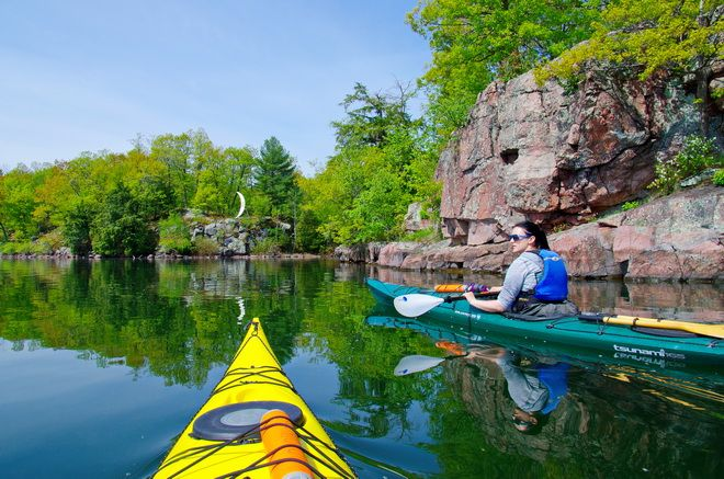 Kayaking around Half Moon Bay in the 1000 Islands, Ontario