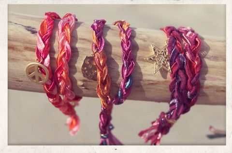 Braided, With Love wrap bracelet collection. Made from 14k gold plated charms and silky satin ribbons.