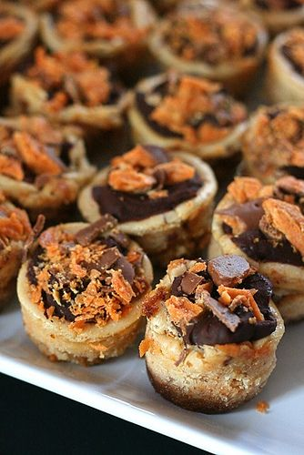 Butterfinger mini cheesecakes - I think they could use some crumbed Butterfingers in the crust as well