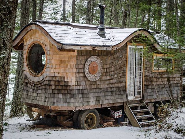 "This fully-functional, 160-square-foot wagon resides in a Canadian forest and is made ""out of mostly recycled materials using an 8-by-20 foot salvaged truck chassis for a base,"" according to The Huffington Post."