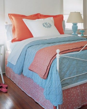 Repeating two bright colors unifies the varied look of this bed, and the bedroom overall.