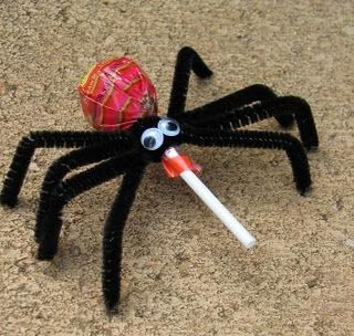 To make spider pops you will need lollipops, black pipe cleaners and small wiggly eyes ...center the pipe cleaner around the lollipop stick making sure both sides are even and then twist them tight .... repeat 4 times to make 8 legs .... glue on the wiggly eyes .... bend the ends of the pipe cleaners so they look like spider legs .... ta dah done!