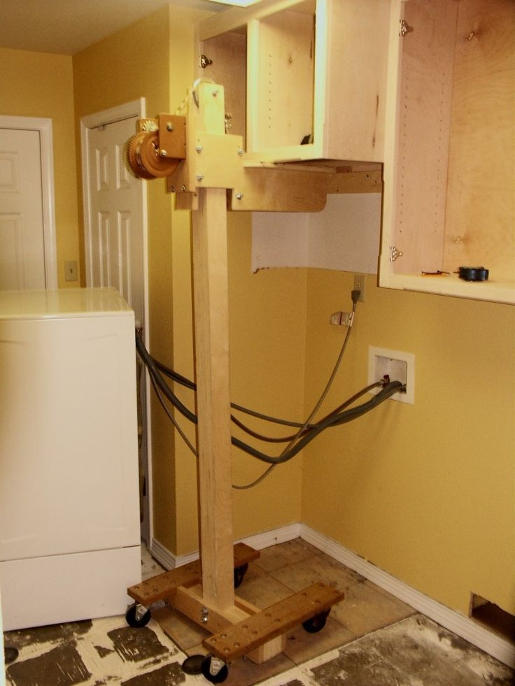 Cabinet Lift by Kerry Fullington -- Homemade cabinet lift constructed from lumber, wheels, and a winch. http://www.homemadetools.net/homemade-cabinet-lift-2
