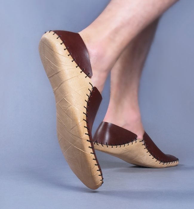 this looks like a really simple shoe to make, with relatively little stitching.  You'd have to have a mold though to put the sole leather on.