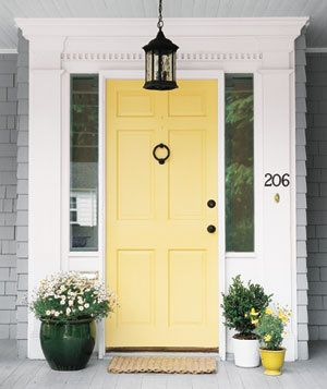 Yellow front door grey house white trim real simple.