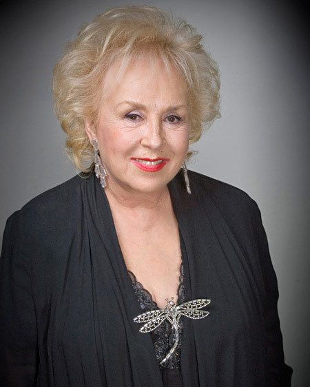 Doris Roberts (born Doris May Green; November 4, 1925-April 17, 2016) is an American character actress of film, stage, and television. She has appeared in numerous Broadway shows including The Desk Set, The Last of the Red Hot Lovers and Bad Habits. She has received five Emmy Awards and a Screen Actors Guild award during her acting career, which began in 1952. She is perhaps best known for her role as Raymond Barone's mother, Marie Barone on the sitcom Everybody Loves Raymond (1996–2005).