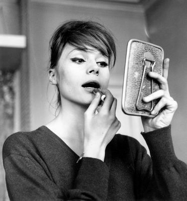 young Francoise putting on lipstick