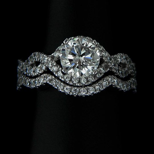 Infinity - Wedding Ring Set....man made diamonds, conflict free (who needs the real thing....these ARE real and WAY better deal!)