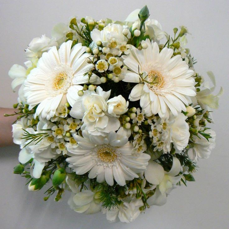 All white posy of mini gerberas, spray carnations, orchids & Geraldton wax