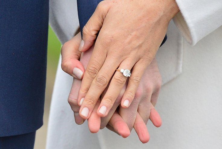 The diamonds flank a larger central stone from Botswana, where he and his fiancée, Meghan Markle, went on vacation early in their relationship.