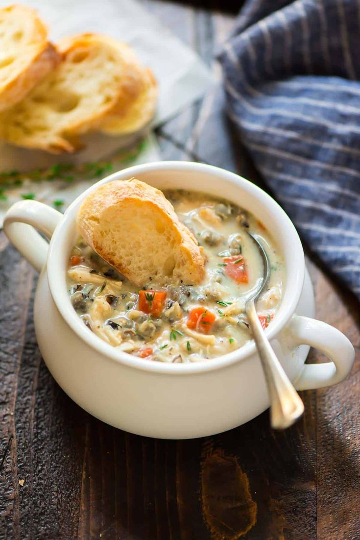 """Slow Cooker Creamy Chicken and Wild Rice Soup. Easy, healthy recipe without the """"cream of"""" soup. Tastes even better than Panera! Make in a crockpot or an Instant Pot. via @wellplated"""