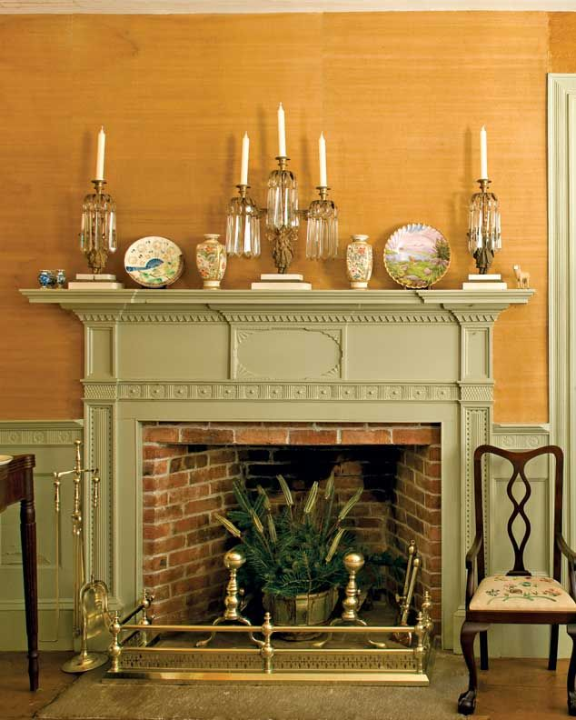 Federal fireplaces were known for beautiful and ornately carved mantels, like this one featuring pilasters, inset panels, and dentils.