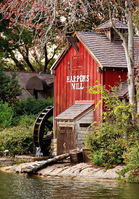 "Harpers Mill in Frontierland at Magic Kingdom Park, Orlando, FL.  ""Did you know the gears inside Harper's Mill creak to the tune of Down by the Old Mill Stream? There's Tom Sawyer's raft resting on the shore in front of the mill."""
