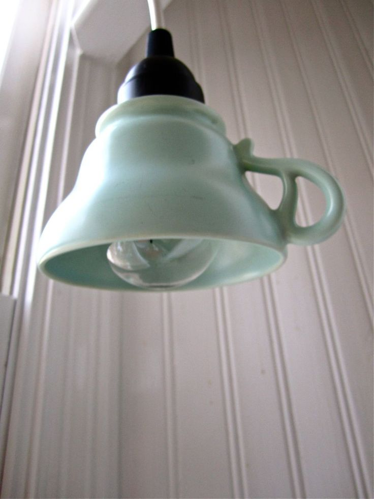 Create a light fixture with an old coffee/tea cup.