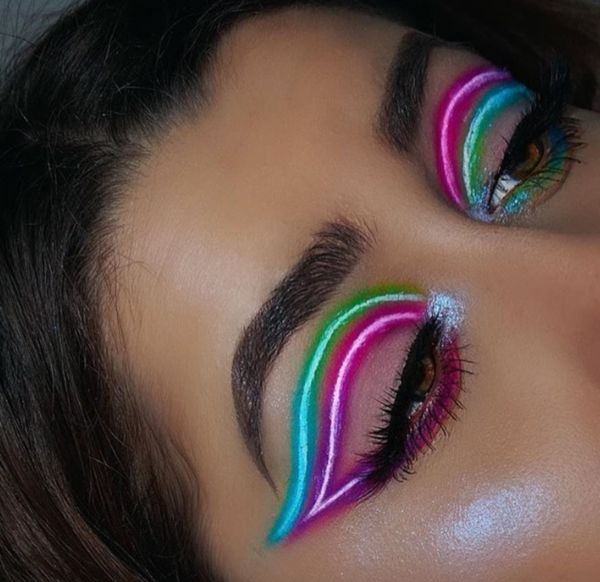 The beauty of light-up makeup is that you can call the look whatever you want. GLOW, Vegas, a neon taco truck sign—so many possibilities.