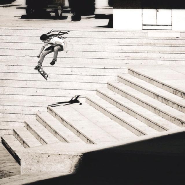 Nyjah Huston, Skateboarding Black and White Photography no runway. Insane pop. Perfect 360 flip.