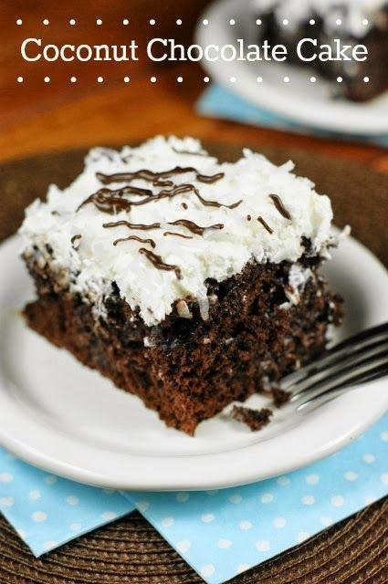 Coconut Chocolate Cake {with Coconut Whipped Cream Frosting} ... super moist, super tender, and super delicious.   www.thekitchenismyplayground.com