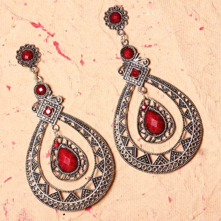 These earrings are based on metal. It is a double looped as it has a maroon stone in the inner loop and the loop outside has metallic design.      Fashion Statement      You may attempt them with some of your traditional dresses.