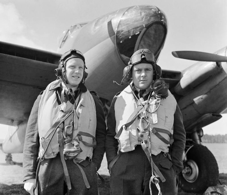 Wing Commander R W Reynolds (right), CO of No. 139 Squadron RAF, with his navigator, Flight Lieutenant E B Sismore, and a de Havilland Mosquito Mk IV at Marham, Norfolk, 1943.