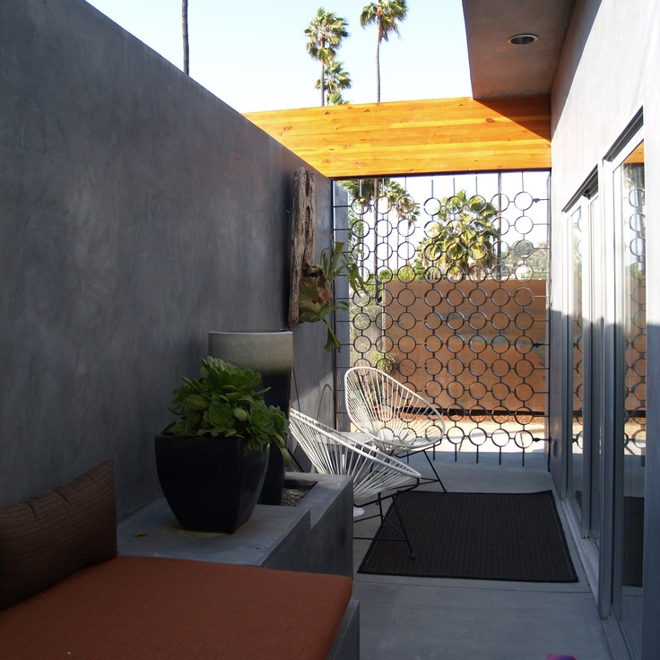 Narrow concrete and wood outdoor space Best