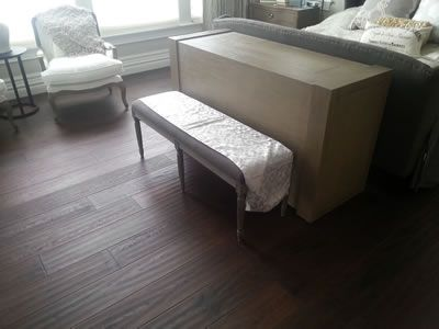 Studio modern TV cabinet shown at end of bed