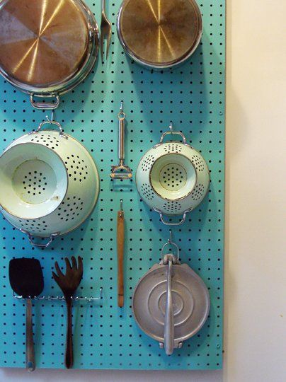DIY Peg Board - great for hanging kitchen accessories (pots, pans, utensils) in a small kitchen with sparse cabinet space
