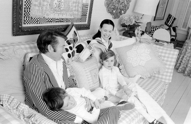 Gloria Vanderbilt, Wyatt Cooper and their sons pose for a family portrait as they play on a sofa in their home on March 30, 1972 in Southampton, Long Island, New York.