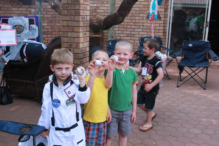 "Space/Rocket Ship/Astronaut Party game. 5 Sweets in a foil ball was hidden all over the backyard. The astronauts in training had to find the ""Moon Rocks"" as part of there ""training"""