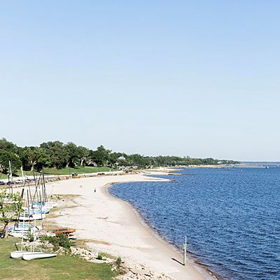 Ocean Springs, Mississippi. A 20-minute stroll from downtown, Front Beach gently arcs from Biloxi Bridge to the Ocean Springs harbor. With a fishing pier, a playground, and views of the Gulf Islands, this beach is a true community destination. | Coastalliving.com