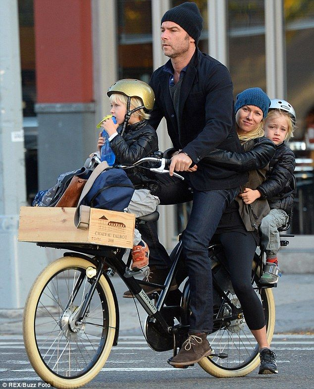 Naomi Watts clings to Liev Schreiber as he uses serious pedal power to ride bike with whole family on board