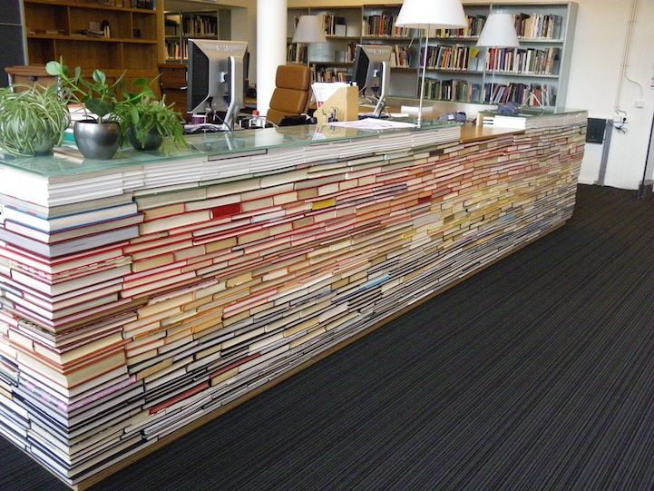 a library desk made from recycled books