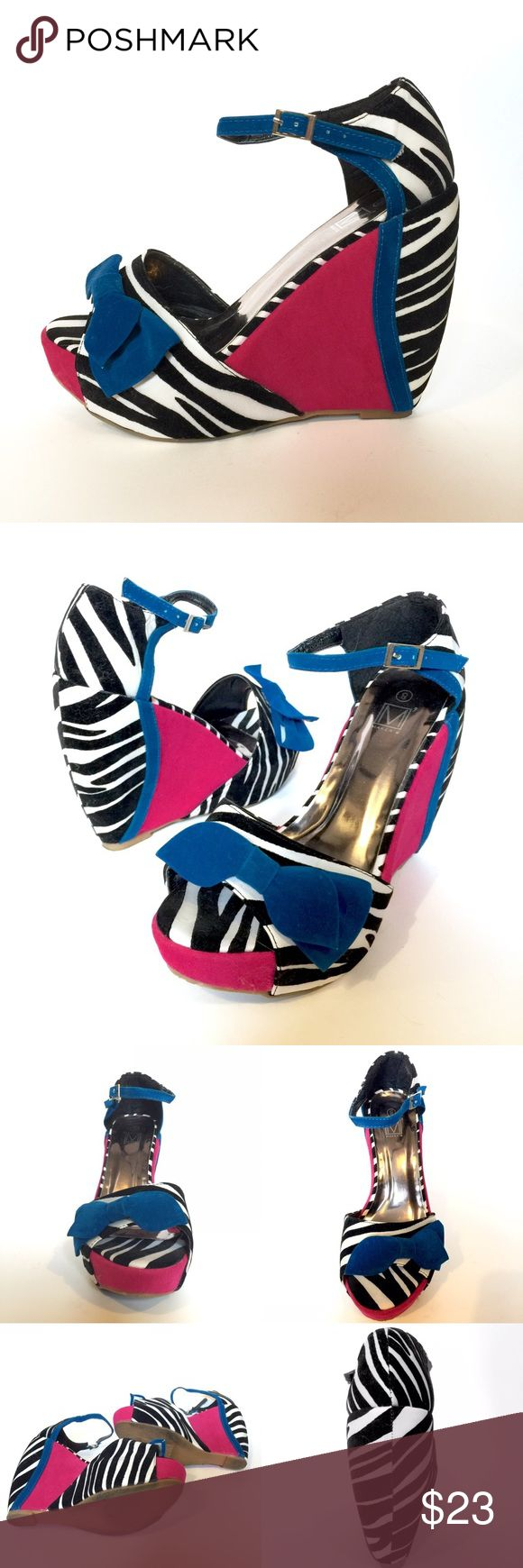 Maker's Zebra Print & Hot Pink Wedge Sandals Like-new condition, zebra print Maker's wedge sandals. Vibrant pink color accents with true blue trim and strap. Size 8. All items come from a smoke-free home. Tags: vintage, retro, pinup, pin up, rockabilly, psychobilly, animal print, Bettie Page, Bernie Dexter, Tatyana, Kitschy, dolls kill, dollskill, nasty gal, YRU, platform, rave, kawaii, Japanese street style, iron fist makers Shoes Wedges